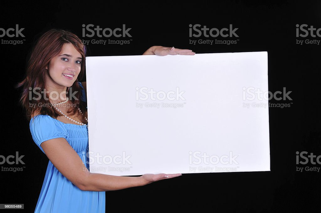 lovely young teen holding a sign royalty-free stock photo