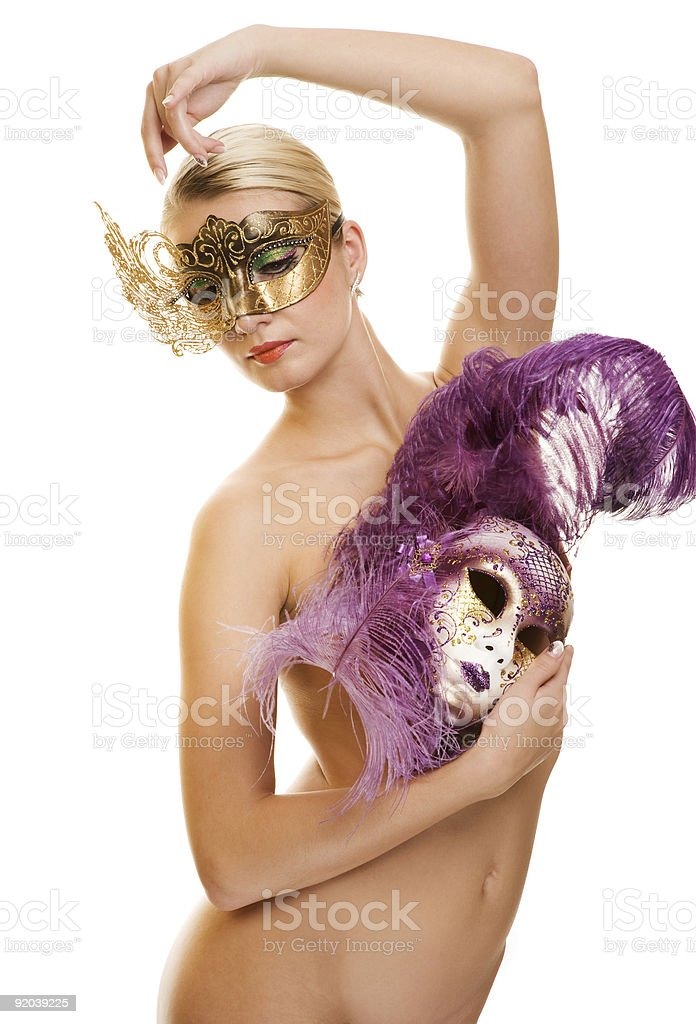 Lovely young woman with carnival mask on her face royalty-free stock photo