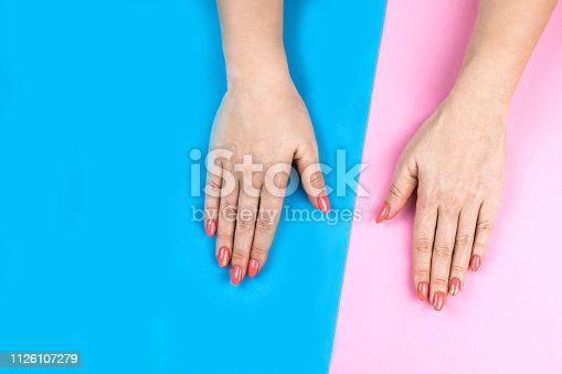 1128559926 istock photo Lovely young woman's hands on colored background. 1126107279