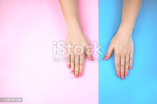 1128559926 istock photo Lovely young woman's hands on colored background. 1126107282