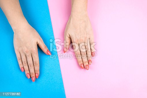 1128559926 istock photo Lovely young woman's hands on colored background. 1127735182
