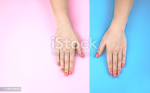 1128559926 istock photo Lovely young woman's hands on colored background. 1128559926