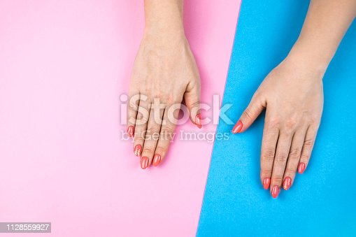1128559926 istock photo Lovely young woman's hands on colored background. 1128559927