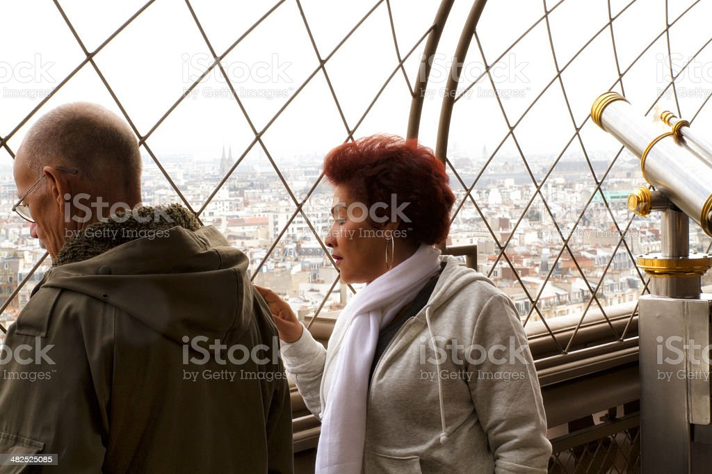 Lover admiring the landscape from the Eiffel Tower stock photo