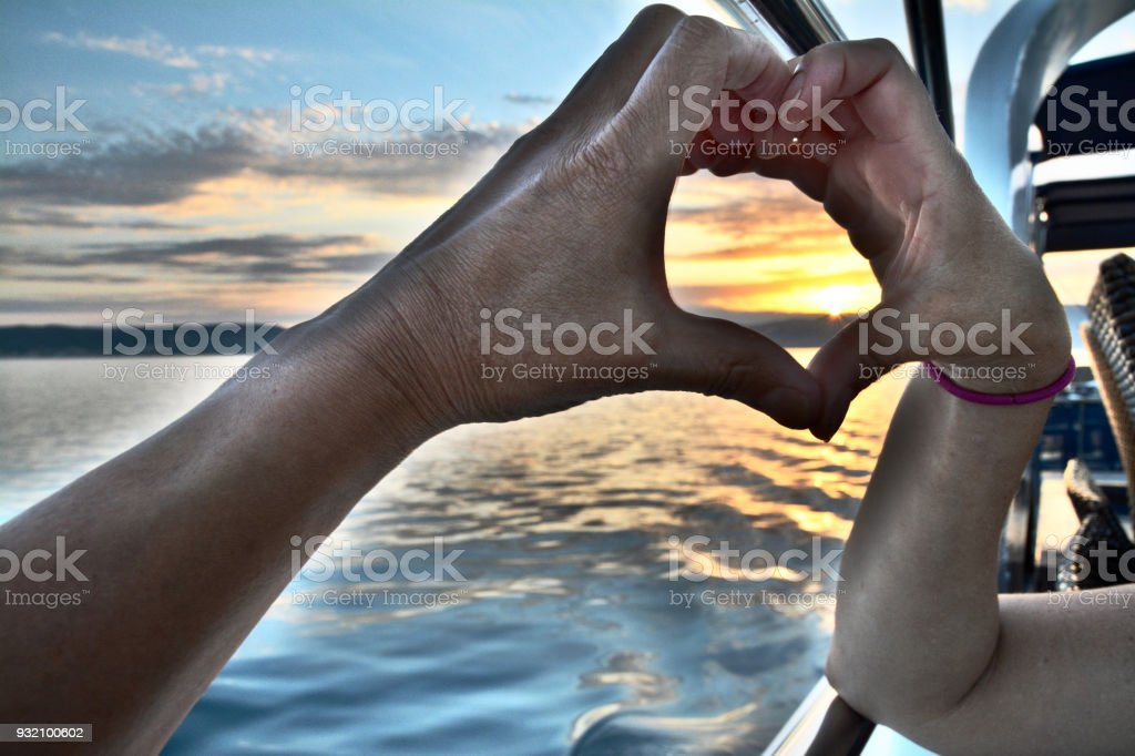 A Asian Male and Caucasian Female Place their Hands together to the...
