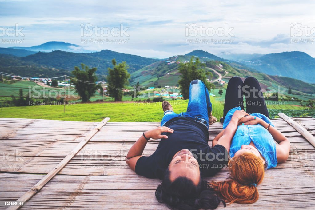 Lover Men and women Asia travel relax. Morning atmosphere nature Forests, mountains. Phu Thap Buek Thailand stock photo