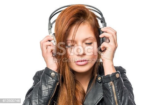 lover of music enjoying the melody with headphones, portrait on a white background