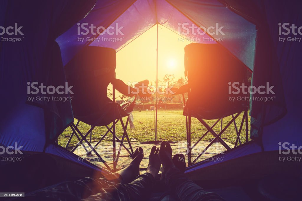 Lover women and men asians travel relax in the holiday. camping on the Mountain. Thailand stock photo