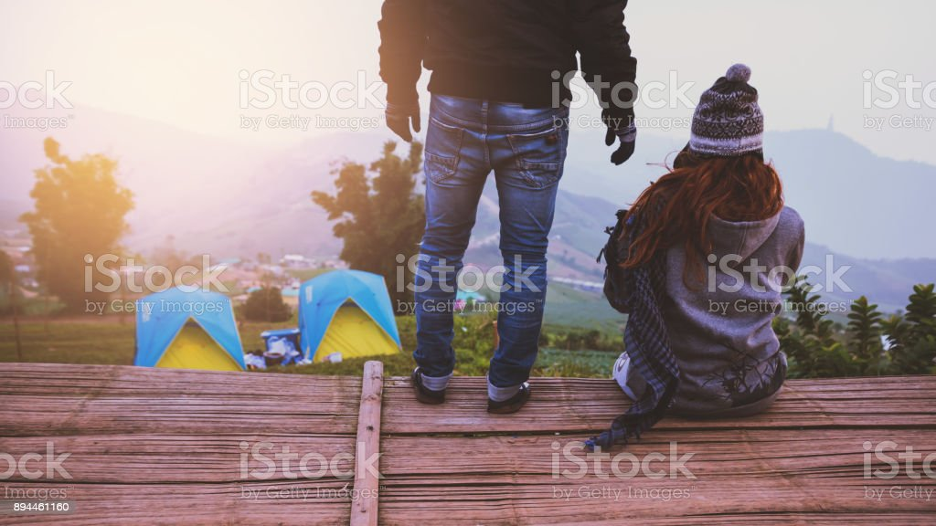 Lover women and men asians travel relax in the holiday camping. watch atmosphere in the morning. Thailand stock photo