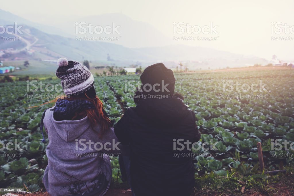 Lover women and men asians travel relax in the holiday. 'nSit and watch atmosphere in the morning. Thailand stock photo