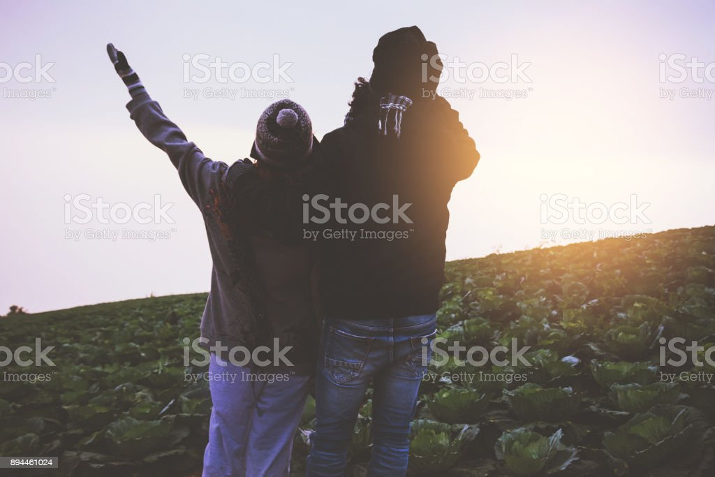 Lover women and men asians travel relax in the holiday. Stand up look landscape on the mountain in the morning. Thailand stock photo