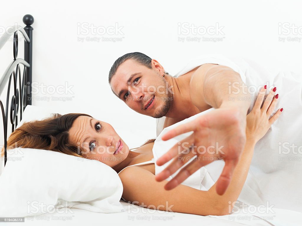 Lovers caught during adultery Lovers caught during adultery in bed Activity Stock Photo