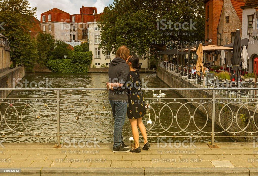 lovers couple at historical bridge at brugge belgium stock photo