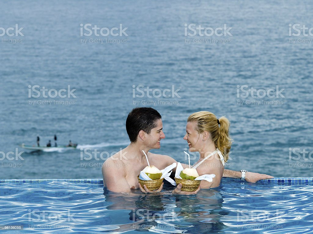 lovers couple in a swimming pool by the seaside royalty-free stock photo