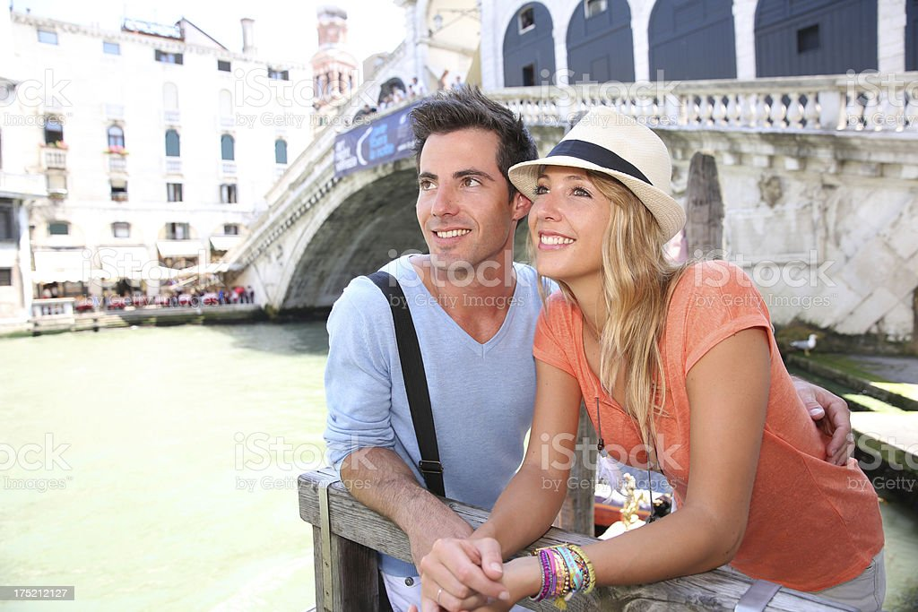 Lovers discovering Venice for first time royalty-free stock photo