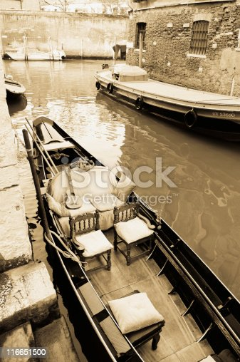 nice cushioned venetian gondola and the guitar is already there and everything else is empty and waiting for the both of you.