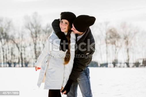 872969580 istock photo Lovers Having Fun during a Snowy day 457917889