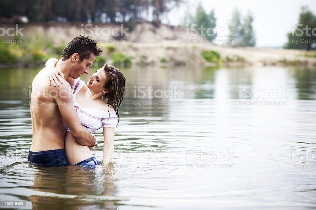 Lovers in lake royalty-free stock photo