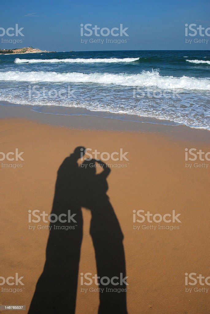 Lovers in the beach stock photo