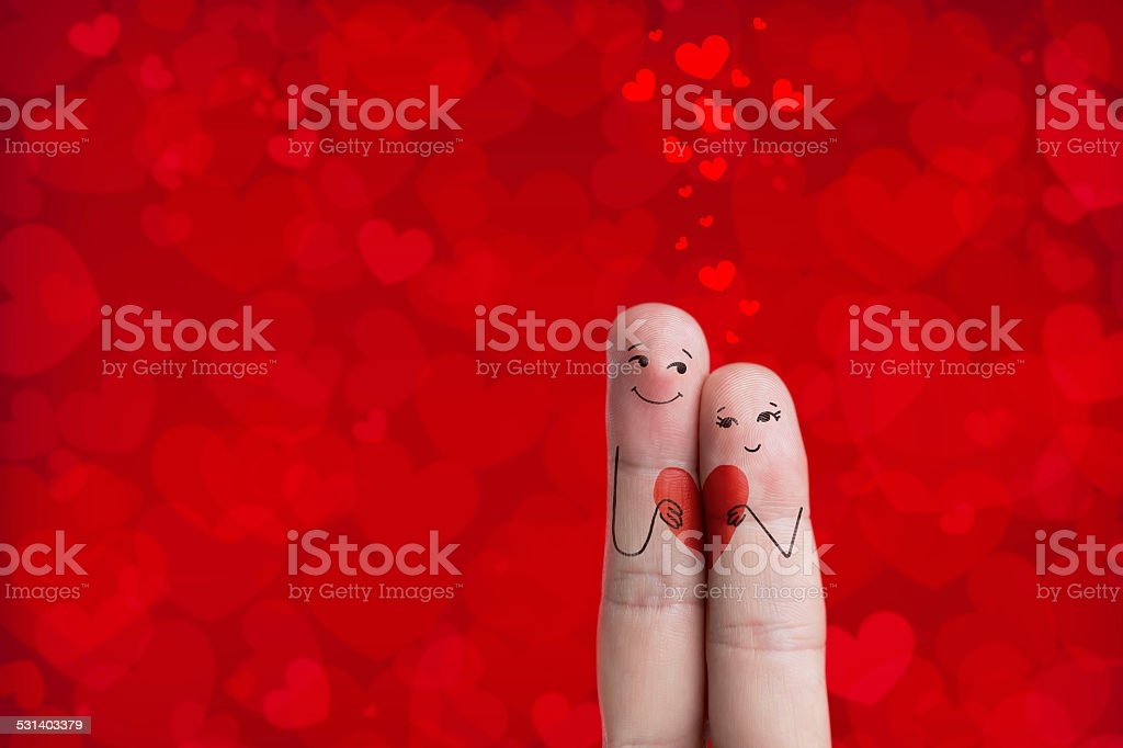 Lovers is embracing and holding red heart stock photo