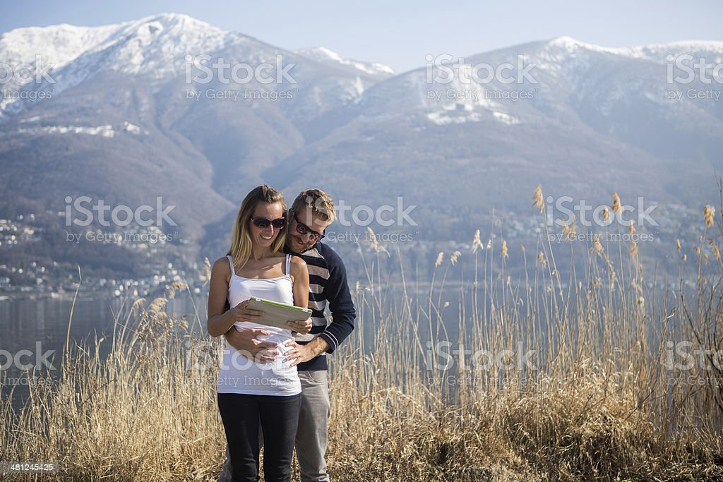 Lovers looking at digital tablet royalty-free stock photo