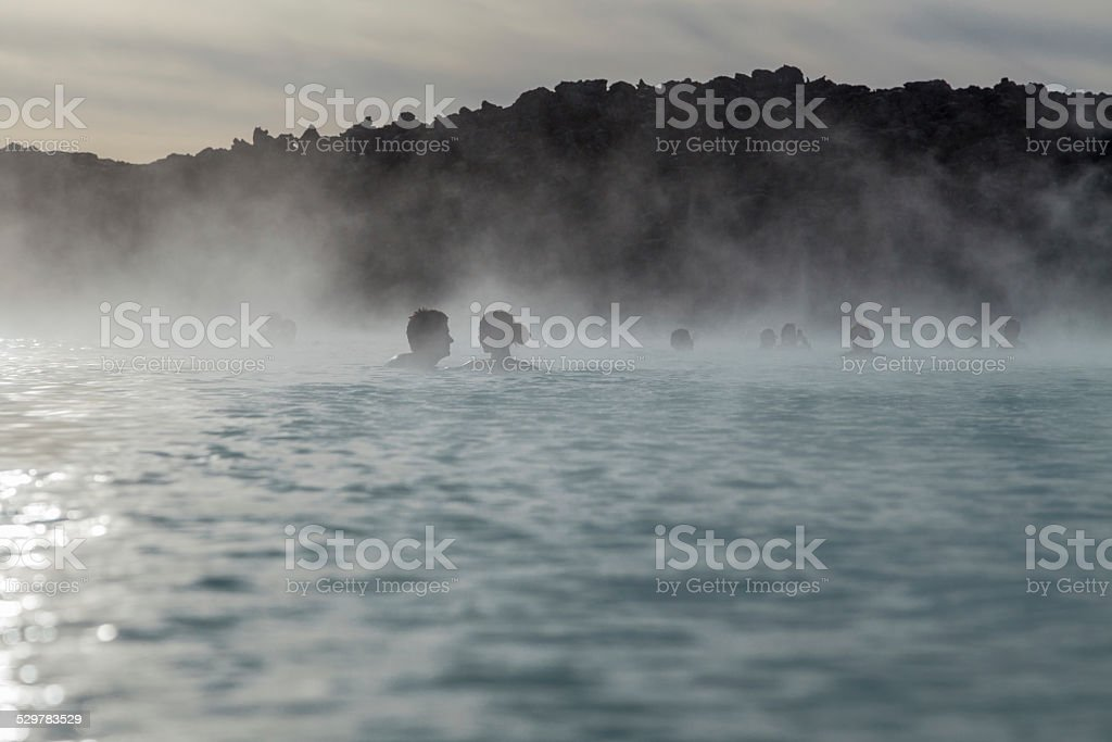 Lovers looking at each other in the Blue Lagoon, Iceland stock photo