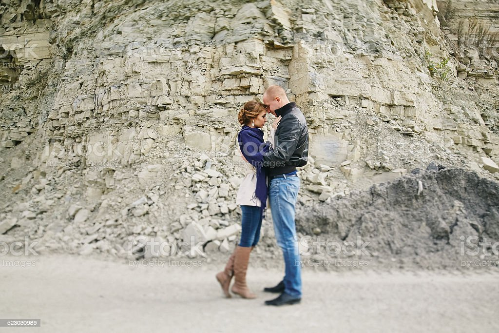 lovers near the sea and mountains stock photo