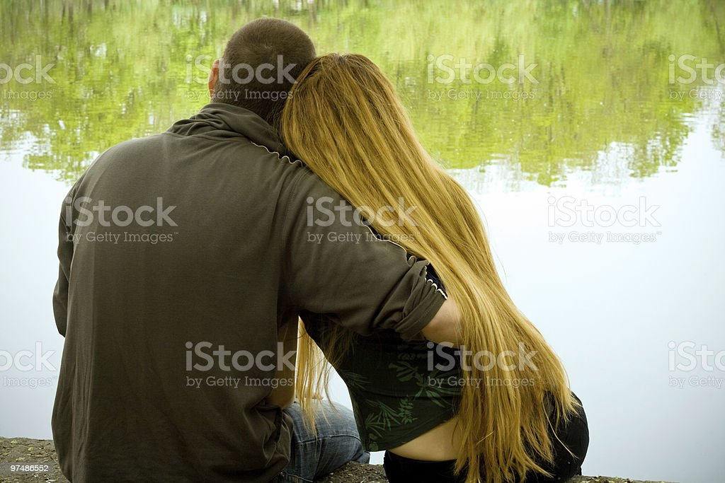 Lovers on lakeside royalty-free stock photo