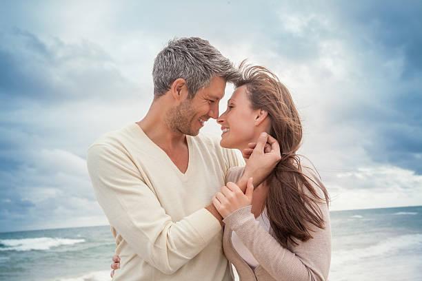 lovers on the beach stock photo