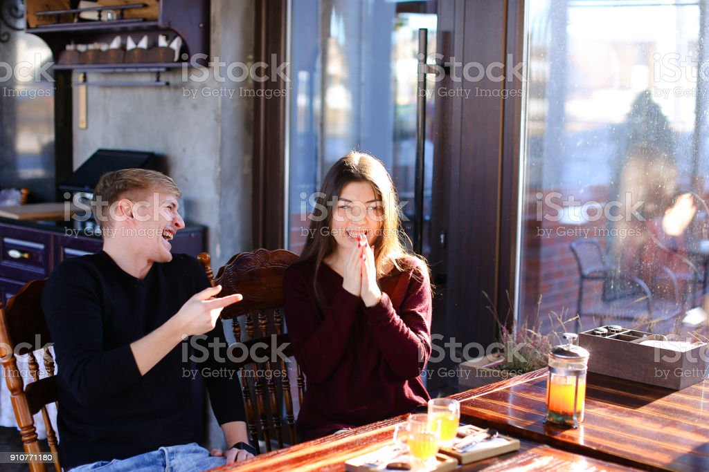 Lovers order hot sea-buckthorn broth in luncheonette after walki stock photo