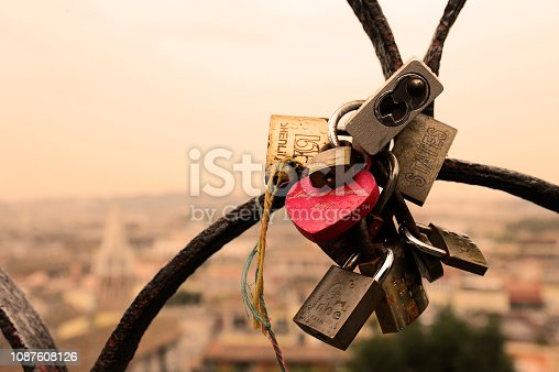 Rome, Italy - October  12, 2018: Lovers padlocks on a bridge. View from the Pincian hill in Rome, Italy