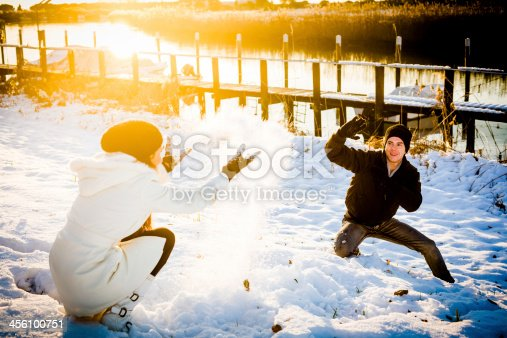 872969580 istock photo Lovers playing with snow 456100751