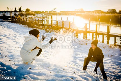 872969580 istock photo Lovers playing with snow 472084073