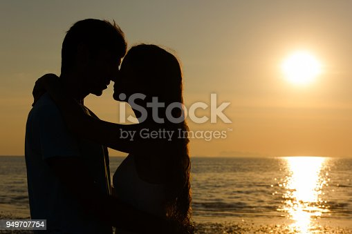 istock lovers silhouette kissing 949707754