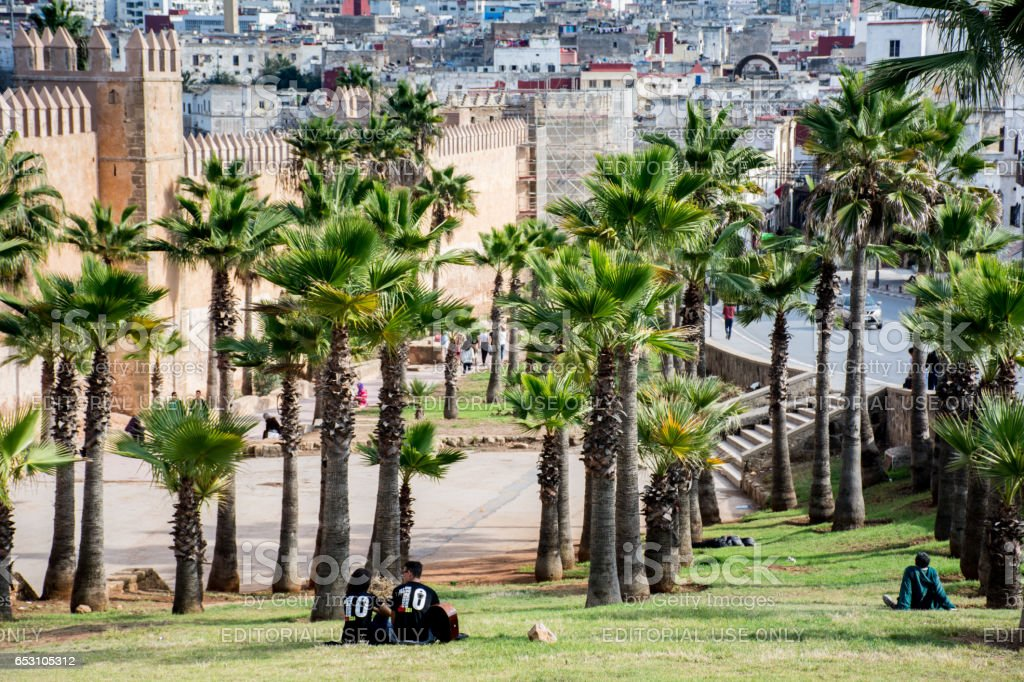Lovers Sitting on a Grassy Knoll in Rabat stock photo