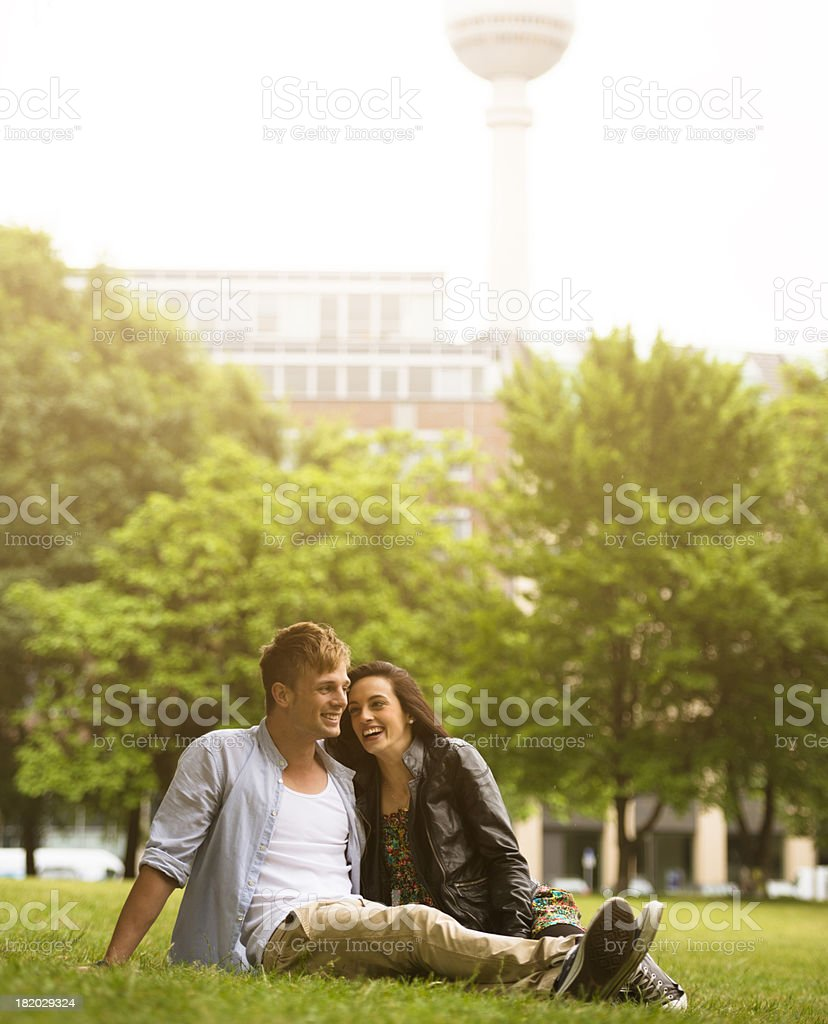 Lovers taking embracing at the park in Berlin royalty-free stock photo