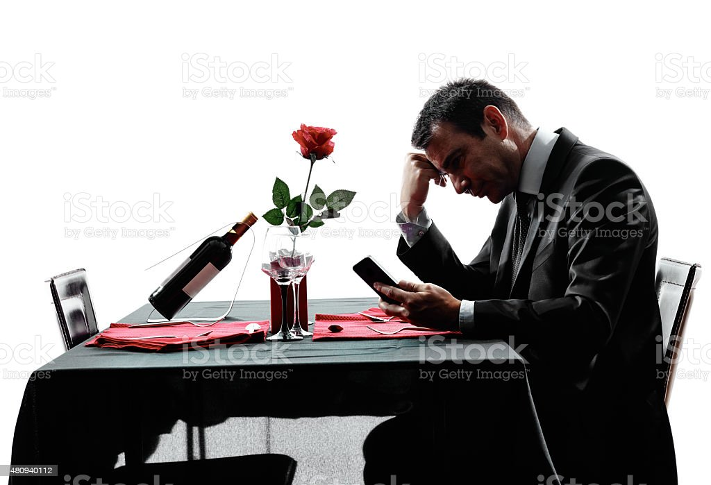lovers waiting for dinner silhouettes stock photo
