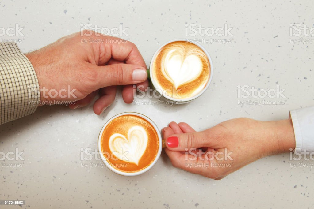 lovers with cups of coffee stock photo
