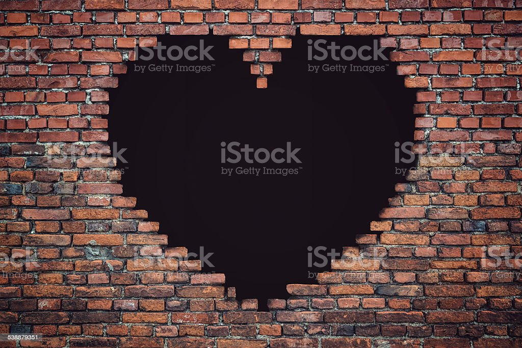 Lovesickness - brickwall with heart shape stock photo