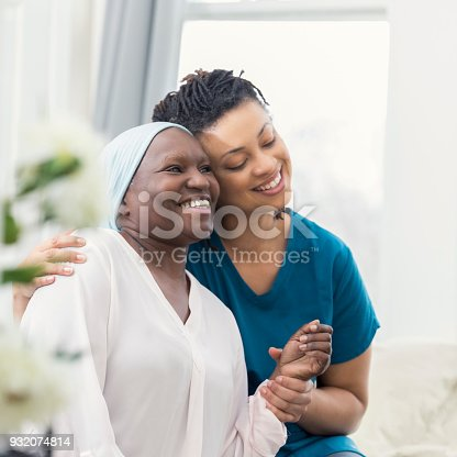 932074776istockphoto Loving adult daughter comforts ill mother 932074814