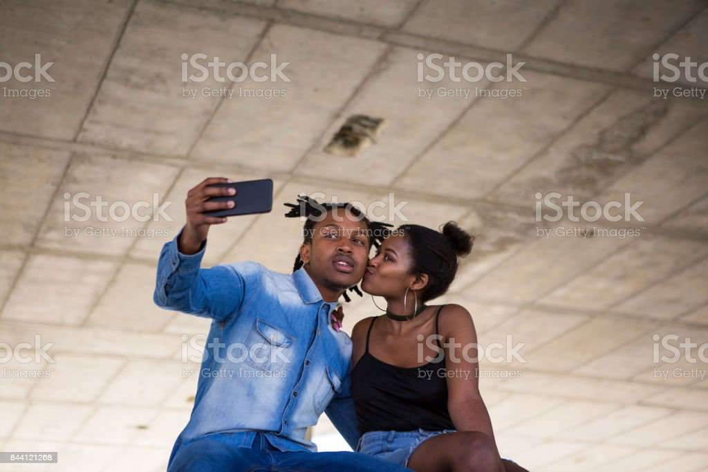 Loving African couple loving taking a selfie of themselves stock photo