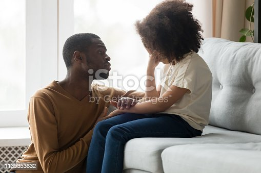 istock Loving african dad comforting crying kid daughter showing empathy 1135353632