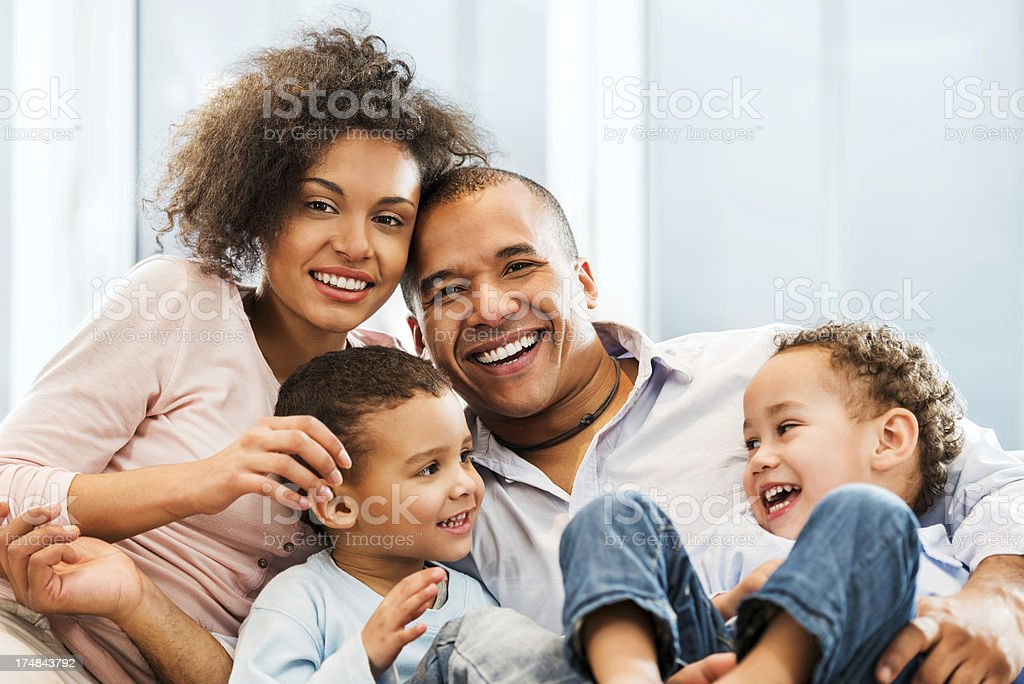 Loving African-American family at home stock photo