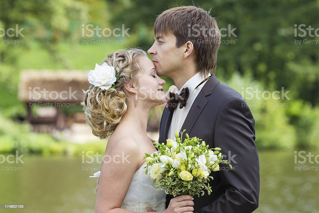 Loving and affectionate pair of newlyweds royalty-free stock photo