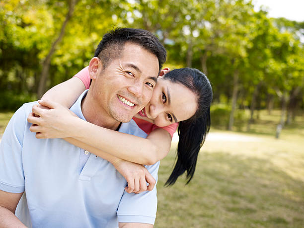 loving and happy asian couple - mid adult couple stock pictures, royalty-free photos & images