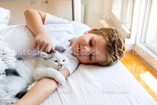 Loving boy cuddling a kitten in bedroom picture id611767256?b=1&k=6&m=611767256&s=612x612&h=qdbipg9 w1x37z g4hhuq69owvaeiusyv2lcx1bvufq=