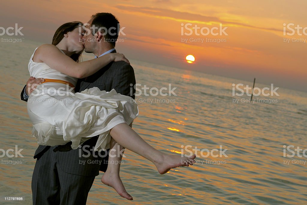 Loving Bride and Groom kissing with mexico sunset & ocean royalty-free stock photo