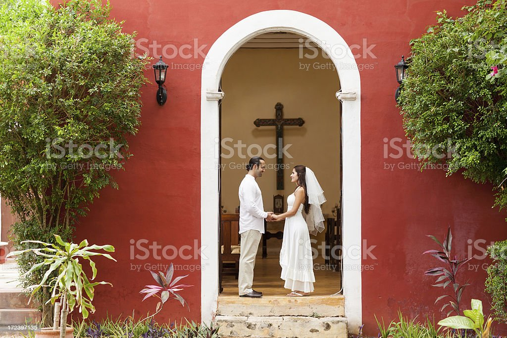 Loving bride and groom outside a church royalty-free stock photo