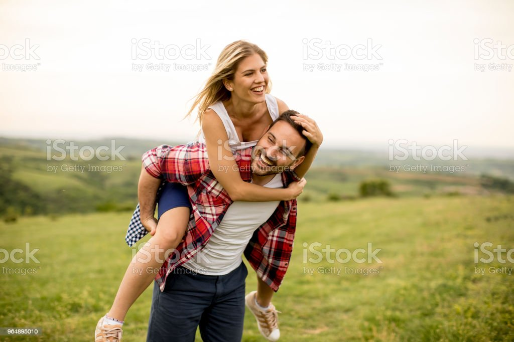 Loving coulpe having fun in the spring nature royalty-free stock photo