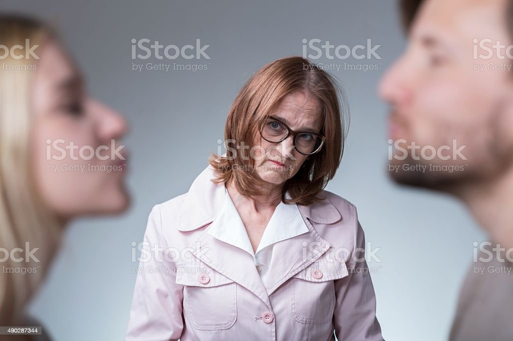 Loving couple and mother-in-law stock photo